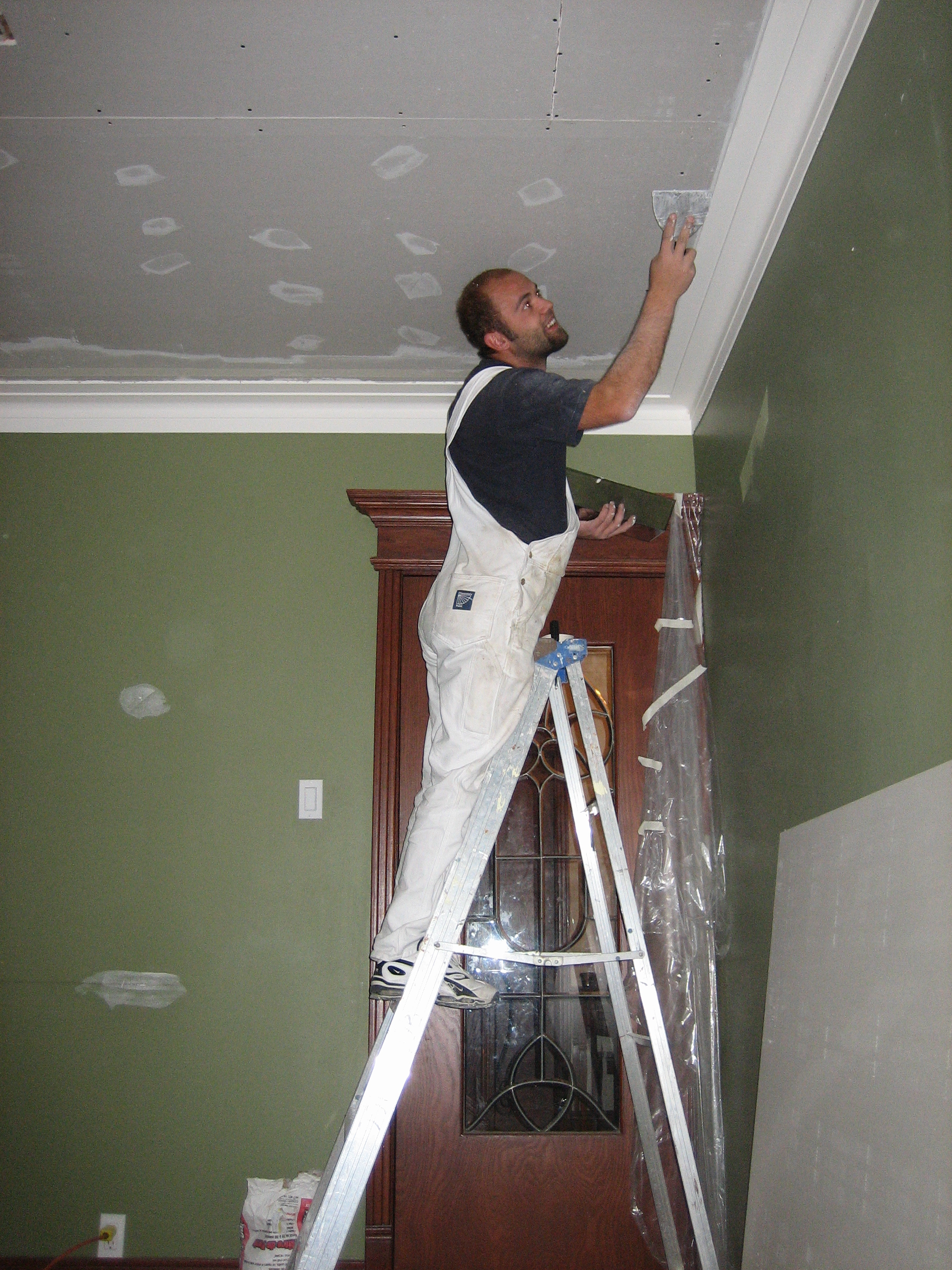 Why ask for a written contract for your painting job for Peintre en batiment